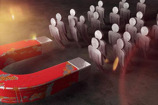 Content Marketing: KMU ziehen Nutzer an wie dern Magnet auf dem Bild die Männchen aus Metall.